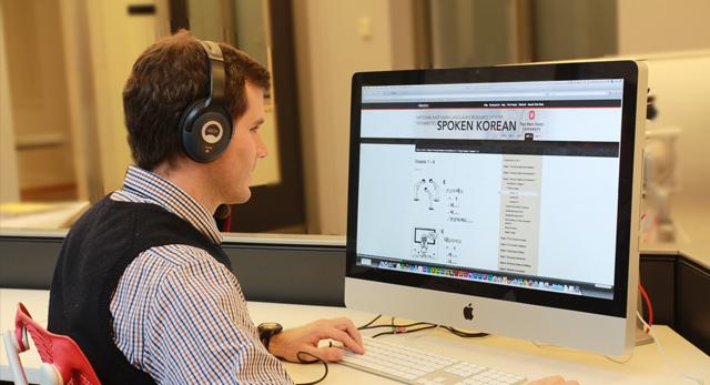Student studying Korean on computer.